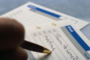 Businessman Writing in Scheduler