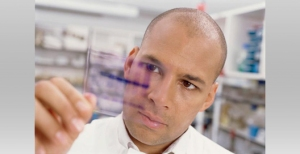 Portrait of a male scientist examining a test slide
